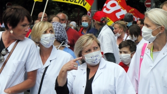 Medical personnel demonstrate against the government's politics