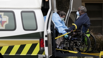 Patient is removed from Southeast Nursing and Rehabilitation Center in San Antonio after COVID-19 outbreak in April.