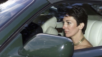 In this Sept. 2, 2000 file photo, British socialite Ghislaine Maxwell, driven by Britain's Prince Andrew leaves a wedding
