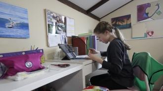 Rachel Keenan, 9, takes a live class online