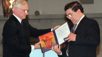 In this 1998 file photo, John Hume looks at his Nobel Peace Prize.