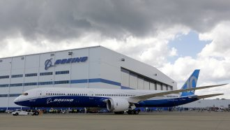 In this 2017 file photo, Boeing employees stand near the new Boeing 787-10 at the company's facility in North Charleston, SC.