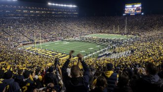 Fans cheer the 2018 University of Michigan Football team as they enter the field