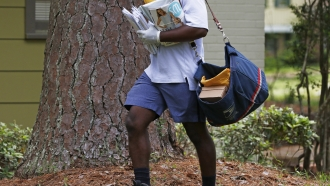 U.S. Postal Service worker delivers mail
