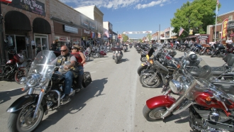 Thousands of bikers rode through the streets for the opening day of the 80th annual Sturgis Motorcycle rally Friday, Aug. 7.