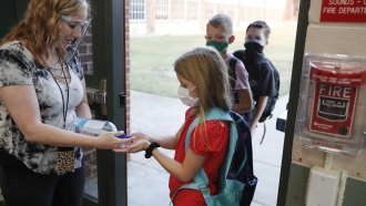 Students enter a classroom in Texas