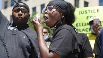 Sheneen McClain speaks during a rally and march over the death of her son, Elijah McClain, outside the police department in A