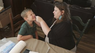 Mendy McNulty swabs the nose of her son, Andrew, 7, Tuesday, July 28, 2020, in their home in Mount Juliet, Tenn.