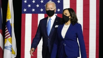 Joe Biden and Kamala Harris arrive to speak at their first joint campaign event in Wilmington, Delaware.