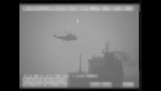 Image of what U.S. military says is Iran seizing a Liberian-flagged ship