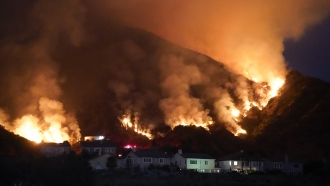 The Ranch Fire burns over a residential area, Thursday, Aug. 13, 2020, in Azusa, Calif.