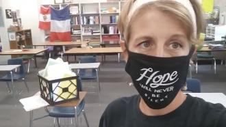 8th grade teacher Erin McCarthy inside her classroom