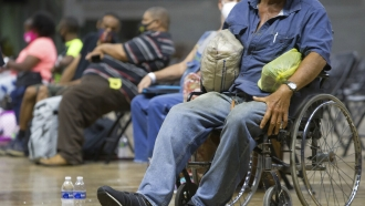 Louisiana residents wait to be evacuated to a shelter.