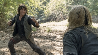 """This image released by AMC shows Norman Reedus, left, and Samantha Morton in a scene from """"The Walking Dead."""""""