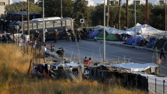 Migrants camp out in Greece after fires
