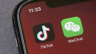 A smartphone displays the TikTok app on its home screen
