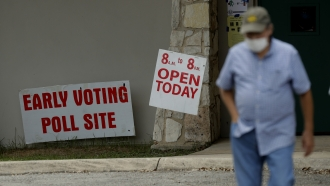 Man walks away from early voting location.