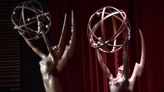 Emmy statues appear on stage