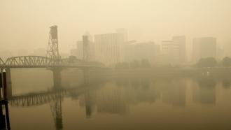 Heavy smoke from wildfires envelops the Willamette Bridge and downtown Portland, Oregon.