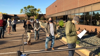 Voters line up outside of the Minneapolis early voting center
