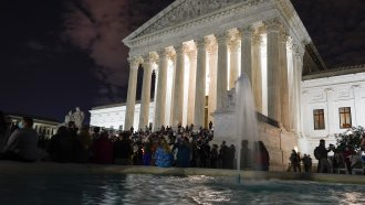 People gather at the Supreme Court Friday, Sept. 18, 2020, in Washington, after the Supreme Court.