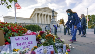 People gather at the Supreme Court after the death of Justice Ruth Bader Ginsburg