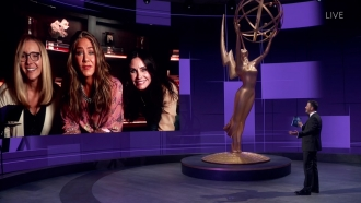 Jimmy Kimmel, right, speaks with Lisa Kudrow, Jennifer Aniston and Courteney Cox during the 72nd Emmy Awards telecast