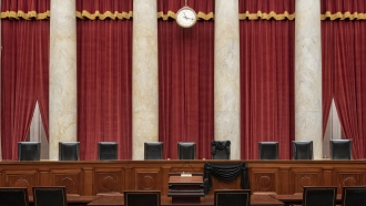 Bench draped for the death of Supreme Court Associate Justice Ruth Bader Ginsburg at the Supreme Court
