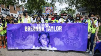Protesters participate in the Good Trouble Tuesday march for Breonna Taylor in Louisville, Ky.