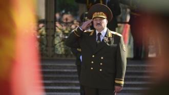Belarusian President Alexander Lukashenko salutes during his inauguration ceremony