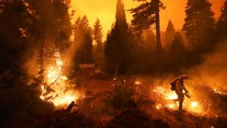 Firefighter Ricardo Gomez fights the Creek Fire in California