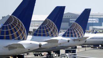 United Airlines commercial jets sit at a gate at Terminal C of Newark Liberty International Airport