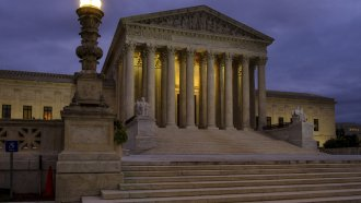 U. S. Supreme Court building stands quietly before dawn in Washington.