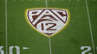 Pac-12 logo on a football field