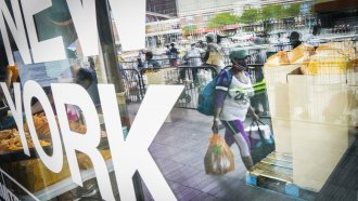 Pedestrians collect fresh produce and shelf-stable pantry items outside Barclays Center.