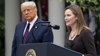 President Trump and Supreme Court nominee Judge Amy Coney Barrett stand in the Rose GArden