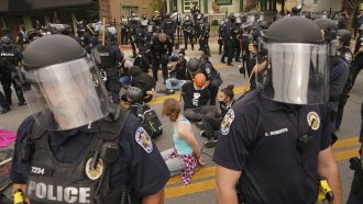 Police detain protesters, Wednesday, Sept. 23, 2020, in Louisville, Ky.