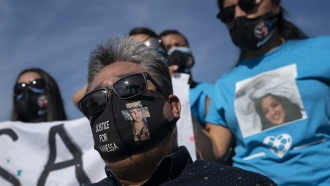 """Slain Army Spc. Vanessa Guillen's father wears a face mask with an image of Vanessa and the words """"JUSTICE FOR VANESSA"""""""