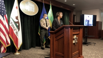 Los Angeles County District Attorney Jackie Lacey announces the arrest of a man.