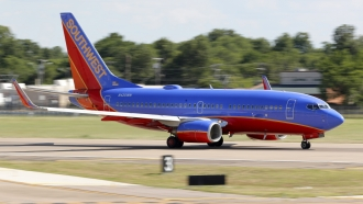A Southwest Airlines jet takes off from Love Field in Dallas.
