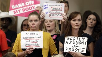 People wait for a Senate hearing to begin to discuss a fetal heartbeat abortion ban.