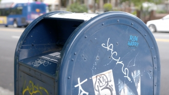 A blue mail collection box