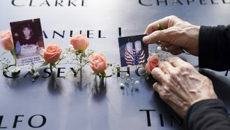Mourners place flowers and pictures at the National September 11 Memorial and Museum.