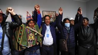 Luis Arce celebrates Bolivian presidential win.
