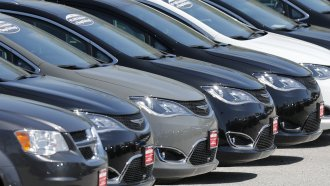Cars are parked in an auto dealer lot in unincorporated St. Louis County, Mo.