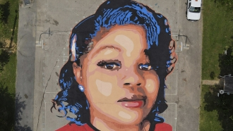 A ground mural depicting a portrait of Breonna Taylor