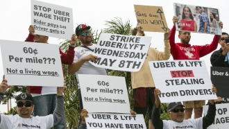 Drivers for ride-hailing giants Uber and Lyft hold a rally.