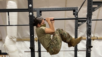 Soldier does leg tuck