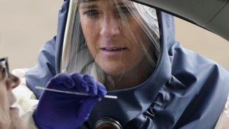 Nurse performs coronavirus test