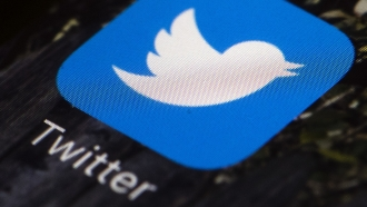 File photo shows the Twitter app icon on a mobile phone.